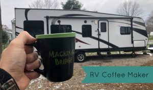 Coffee in front of Toy Hauler travel trailer for best RV coffee maker article